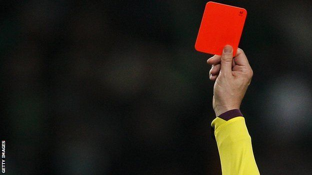 A Ryman Premier League game between Wingate & Finchley and Thurrock has been abandoned after five players from the home side were shown red cards. Visitors Thurrock had a 1-0 lead over their relegation rivals when the match was called off in the 85th minute.