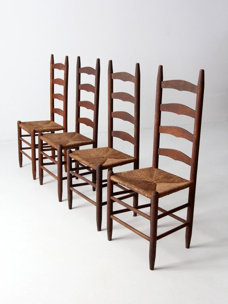 circa late 1800s This is a set of four rush seat ladder back chairs. The wood frame chairs feature tall ladder slat backs. The seats are woven rush. There is a beautiful patina to the wood.  4 chairs wood frame ladder back rush seat  CONDITION In good condition with wear consistent with age and use. There are some light scratches and nicks in the wood. MEASUREMENTS    Height 43 inch 109.2 cm   Width 17.5 inch 44.5 cm   Depth 15 inch 38.1 cm   Seat Height 17.5 inch 44.5 cm     Please review…