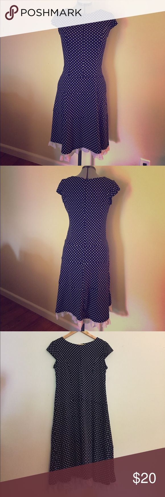 Olivia Matthews polka dot navy cap sleeve dress 10 Olivia Matthews navy with white polkadot cap sleeve midi length dress with lace bottom detail. Light weight fabric with stretch for a flattering fit. Size 10. Great condition! Olivia M Dresses Midi
