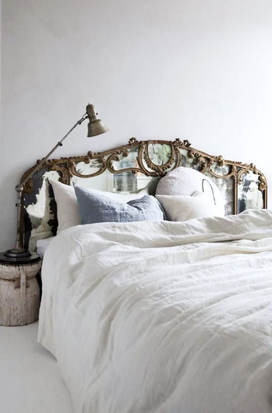 vintage vibe created with mirrored headboard and linen bedding / sfgirlbybay