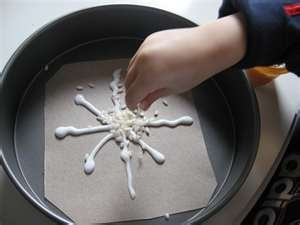 Here's a winter classroom project. Elmer's glue and rice. Snowflake. #winter crafts for kids