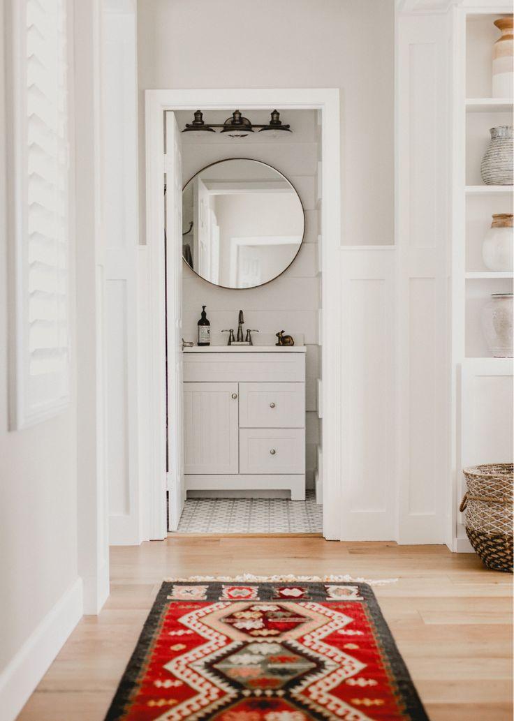 Powder room bathroom world market rug white Benjamin Moore simply white millwork