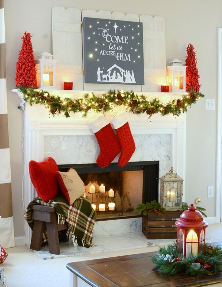 Red and festive Christmas mantel with DIY lit canvas