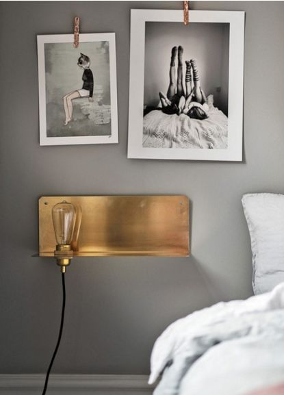 Lovely brass light fixture duals as a shelf