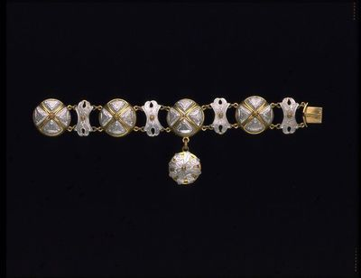 Bracelet made from gilt metal frames onto which engraved aluminium plaques have been rivetted, France | ca.1870 | Victoria and Albert Museum | CC BY-SA