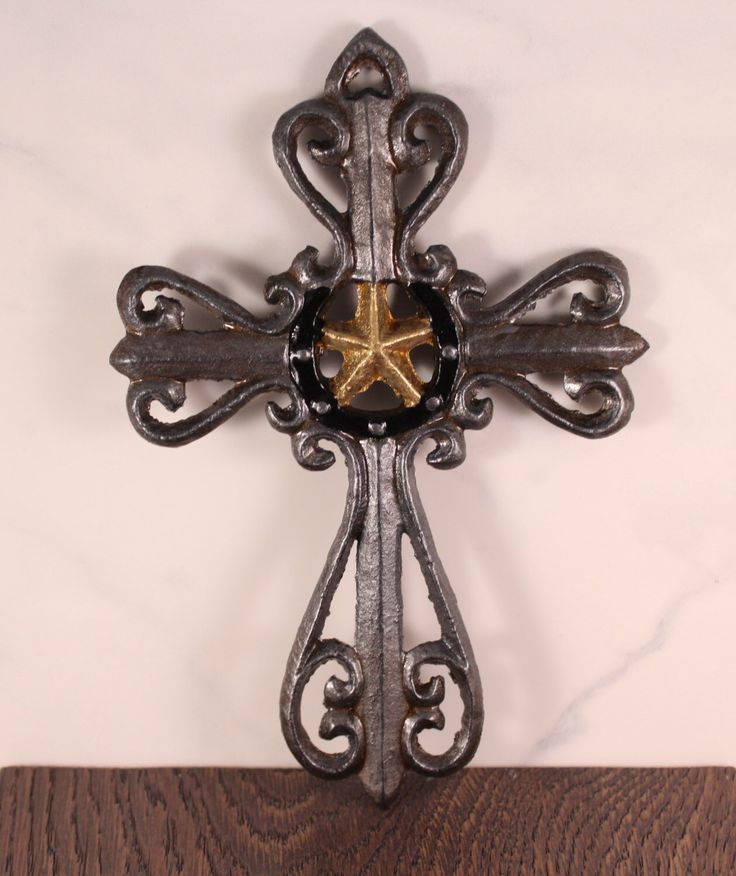 A personal favorite from my Etsy shop https://www.etsy.com/listing/475760307/cast-iron-cross