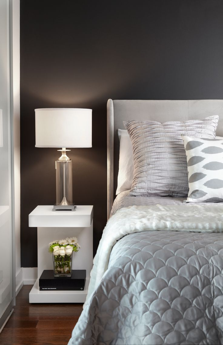 Contemporary condo bedroom with white and gray