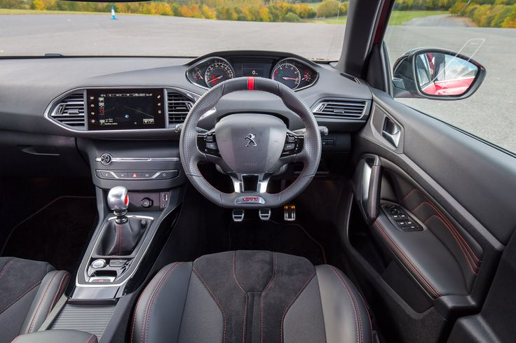 Shot through with GTi sportiness, the interior of the 308 GTi by Peugeot Sport amounts to a declaration of passion.  Red stitch detail can be found on the door cards, seats, gear lever gaiter and luxury deep pile carpet mats.  The steering wheel comes encased in full grain leather and displays the GTi logo plus a red centering mark.