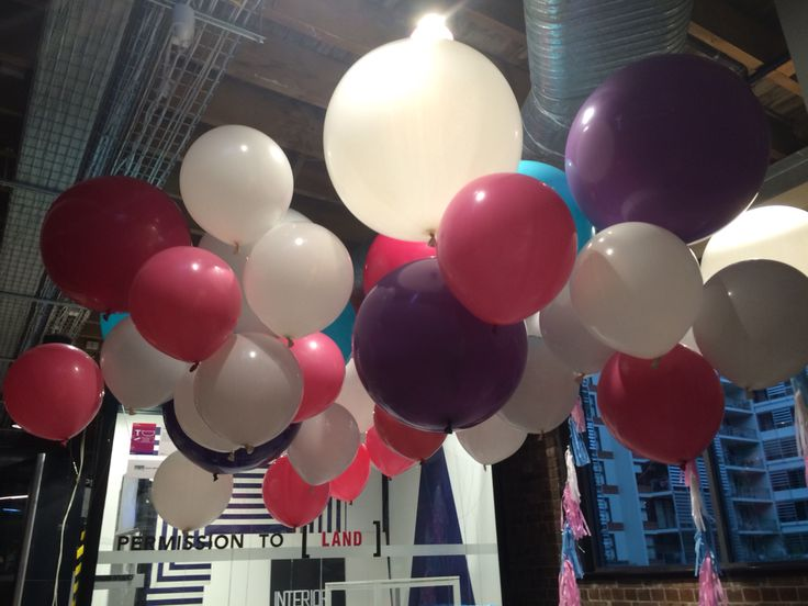 """Mix of 3ft and 17"""" balloons on floor weights."""