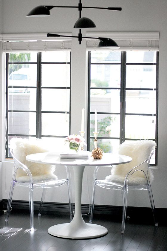 Small Shop Studio   Chic Breakfast Nook Features Saarinen Table Paired With Acrylic  Chairs Accented With Sheepskin Pelts Atop Dark Floors Situated In Front ...