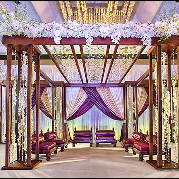 Mahogany mandap, white flowers and crystals by Suhaag Garden photo by Andrew Milne #indianwedding #mandap