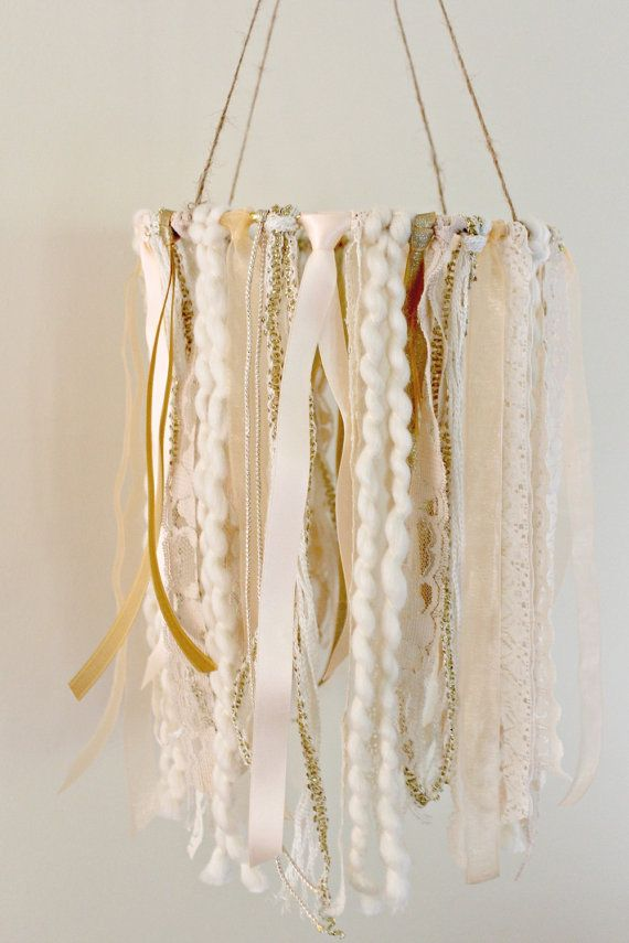 Mobile in creamy beige, peach, ivory and gold tones  This stunning mobile is packed full of beige, peach, ivory and gold lace, fibers and ribbon.
