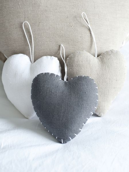white, grey, taupe. stitched hearts from Nordic House