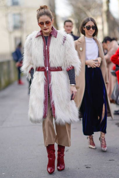 Olivia Palermo wears a white fur coat outside Giambattista Valli during Paris Fashion Week Womenswear Fall/Winter 2018/2019 on March 5 2018 in Paris...