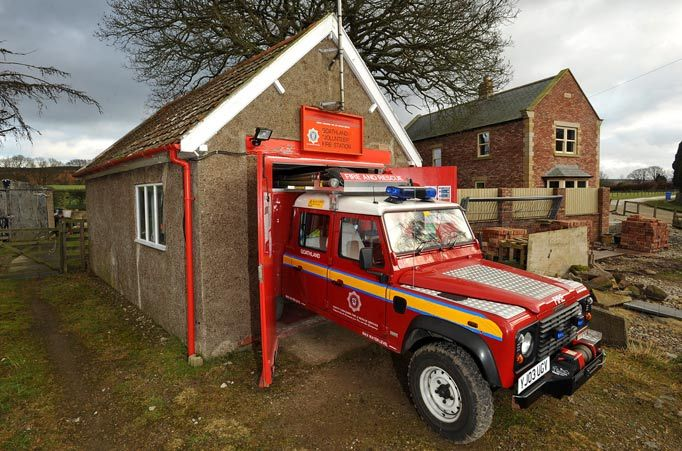 The Goathland Volunteer Fire Station in Yorkshire (UK) is quite possibly the world's smallest. This 20 ft x 13 ft stone building (AKA garage with a double door) fits a 4x4 firefighting Land Rover, desk and a file cabinet.
