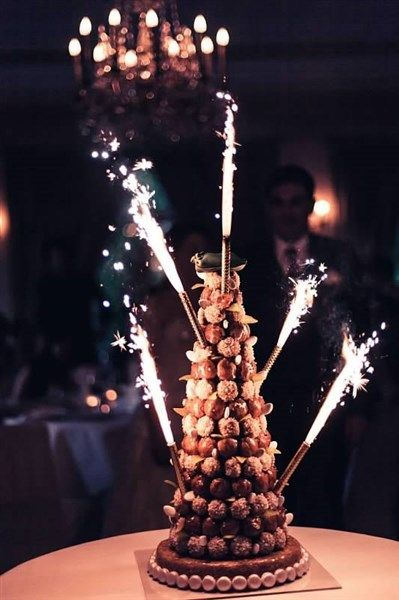 Wedding cake: Flourless chocolate cake base with Croquembouche top! (Croquembouche is crafted from profiteroles held together by glazes of spun sugar.)