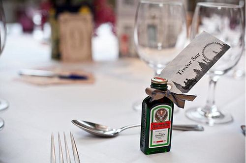Mini bottle of alcohol attached with the persons name for