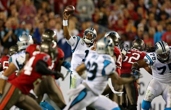 TAMPA, FL - OCTOBER 24: Cam Newton #1 of the Carolina Panthers passes during a game against the Tampa Bay Buccaneers at Raymond James Stadium on October 24, 2013 in Tampa, Florida. (Photo by Mike Ehrmann/Getty Images)