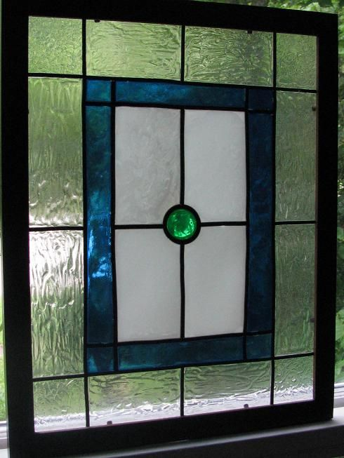 Fullsized 'stain glass' panels I painted on cheap poster frame glass for gifts. I did use the stick down lead lines. I did not like working with the Gallery Glass brand paint. I had more success with was air dry Delta glass paint (transparent). (bookmarm on the greenleafdollhouses forum.)