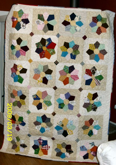 memory quilt made from ties, more traditional looking than most tie quilts i've seen :)