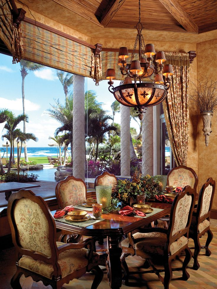 Set within a bay of high-impact windows overlooking a panoramic view of sea and sand, this breakfast room rates high as the family's favorite dining area. Overhead, an octagonal ceiling shapes a charming setting for the mahogany table and chairs from Arte de Mexico.