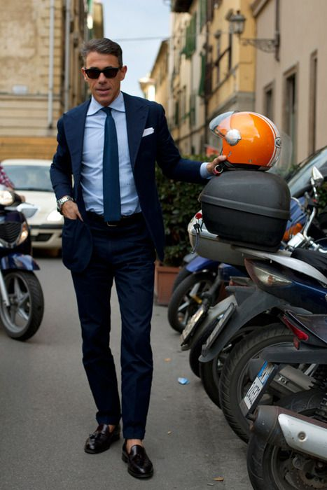 Italian men know what's up. Americans don't dress like this, and if they do, they're not getting off of a motorcycle.