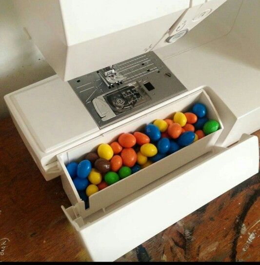 Brilliant!  M&Ms storage in sewing machine. I am going to hide Skittles in mine!
