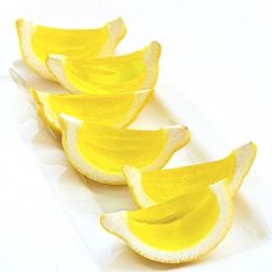 Lemon jello shots in lemon peels.  I made these today and they came out exactly like this!