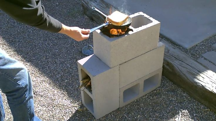 """The """"4 Block"""" Rocket Stove! - DIY Rocket Stove - (Concrete/Cinder Block ...How to make a """"FOUR BLOCK"""" Rocket Stove! Easy DIY. Four concrete blocks is all it takes to make it!. Cost $5.16. video shows you how to put it together. the stove funnels all its heat up under the bottom of the pan. uses very little fuel. fueled by small sticks, twigs and leaves. cooks great. wind and rain resistant)"""