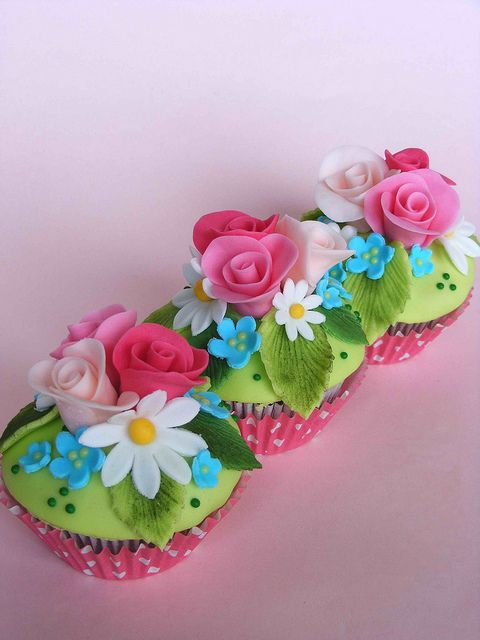Pretty cupcakes. Nice variety of colors and flowers. Great for a garden party.