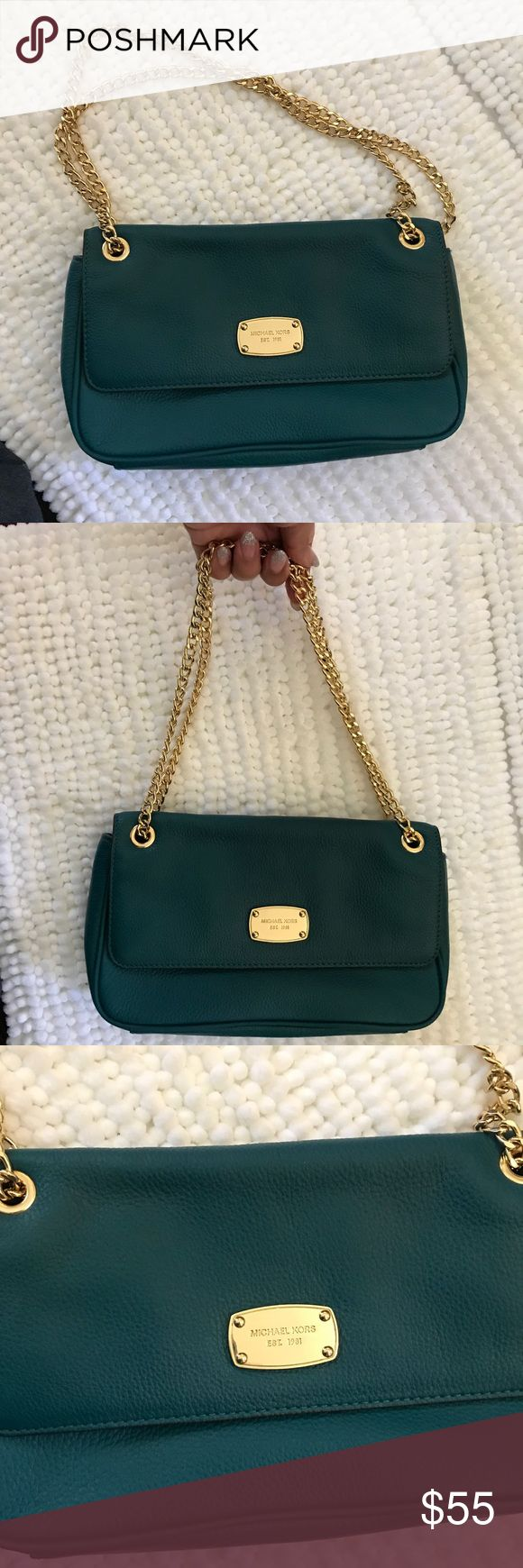 Michael Kors shoulder bag clutch with gold chain Michael kors used in good condition turquoise blue green shoulder bag or clutch mas a magnetic opening and an outer pocket and a gold chain strap this is a used item and may show sign of use a dirty lining or fade or scratches to leather but there is nothing major to report if you'd like more pics please ask Michael Kors Bags Shoulder Bags
