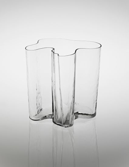 ALVAR AALTO 'Savoy' vase, model no. 3031, 1930s Colourless glass still-blown into mould. 29.6 cm (11 5/8 in) high Produced by Iittala, Finland. Underside incised with 'ALVAR AALTO' Estimate £4,000 - 6,000 from Phillips
