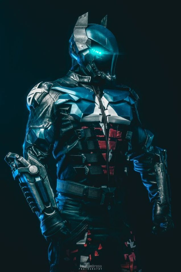 This is a cosplay made with a 3D printer! Cosplayer Crimson Coscrafts teamed up with Graphix Monster for the incredible build and photographer Lucas Ambrosio brought life and lighting to the awesome suit. See more at http://fashionablygeek.com/handmade/arkham-knight-3d-print-cosplay/#csZo1BFowiJAbVTe.99