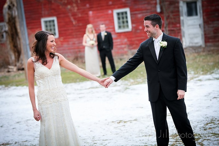 bride and groom with maid of honor and best man in the background....great idea :)