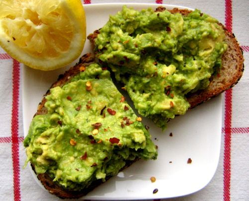 Avocado Toast : Creamy and peppery with red pepper flakes on toasted wheatberry bread moistened with a drizzle of olive oil. Perfect with a spritz of citrus and black coffee.