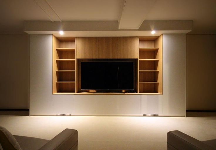 This elegant entertainment unit, in a velvet white finish compliments the feature timber display shelving. This bespoke unit spans 4.5 metres and integrates ducted heating through the base of the unit.What a clever solution in a difficult space.