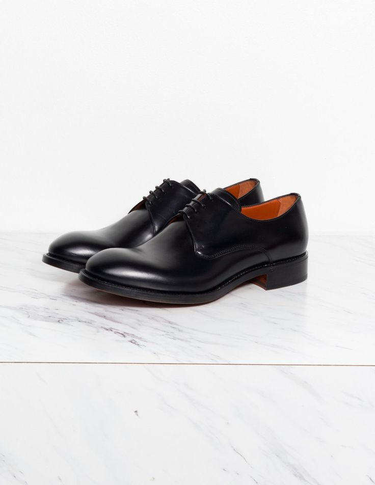 Acne Studios Derby Leather Oxfords Black calf leather oxford lace-up shoes  with stacked leather heel and leather lining, insole, and sole.