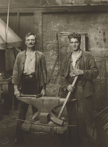 August Sander. Blacksmiths, 1926 Gelatin silver print, 84.XM.126.108 Unlike his images of white-collar professionals that often display individuals in nondescript settings, August Sander's images of laborers explore their visceral connection to working environments and tools of trade. In this photograph, two blacksmiths grasp their hammers while standing in front of an anvil; for Sander, they embodied the pre-industrial craftsman, whom he held in the highest esteem.
