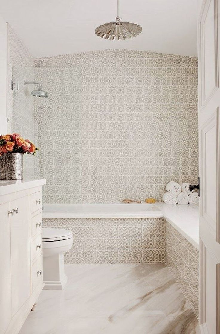 Spanish tiling in a neutral bathroom via Kishani Perera