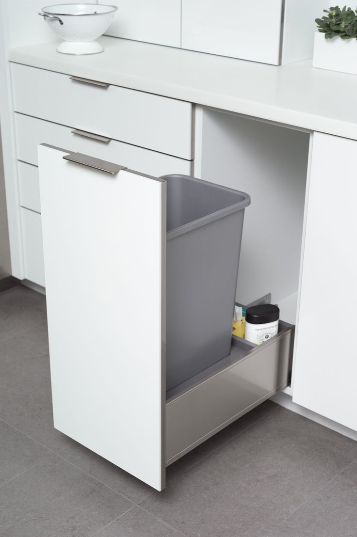 A pull-out trash and recycling bin cabinet can come in Stainless Steel with your frameless Dura Supreme kitchen cabinets – Find more ideas like this at DuraSupreme.com    #durasupreme   #cabinets #cabinetry #kitchendesign #kitchen #kitchens #kitchenremodel   #storage #stainlesssteel #drawers #metal