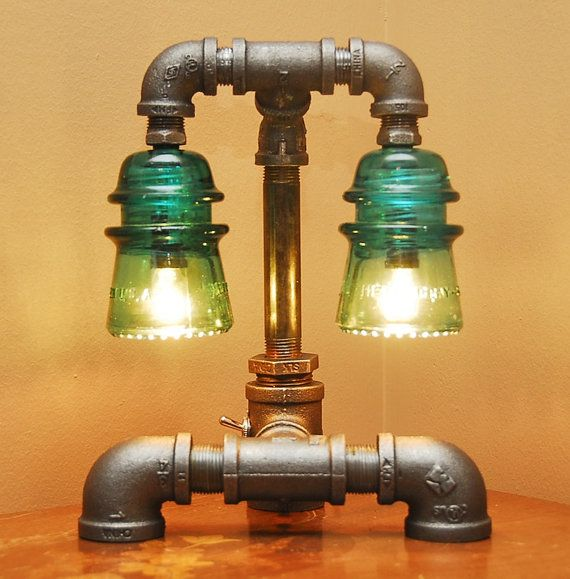 Industrial Style Pipe Lamp with Green Glass Insulators via Etsy