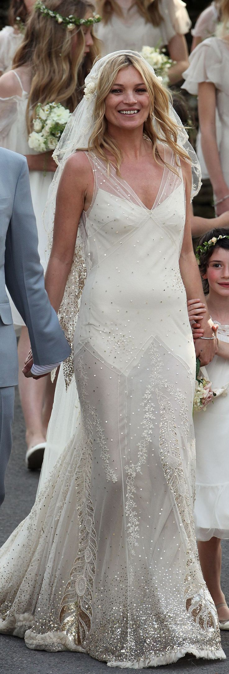 Kate Moss's wedding dress by John Galliano is unbelievable. I cannot imagine what it must have looked like in person.