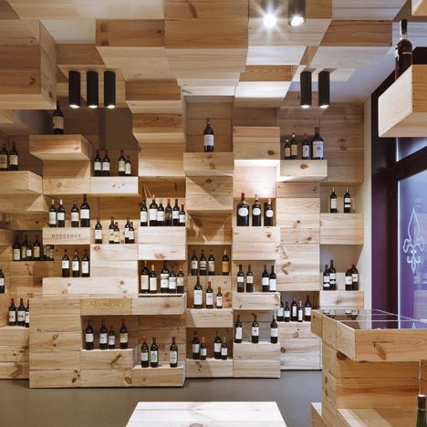 Wine store by OOS. Great  solution for interior concept. The wooden cases are simultaneously an architectural element and a part of the furniture.