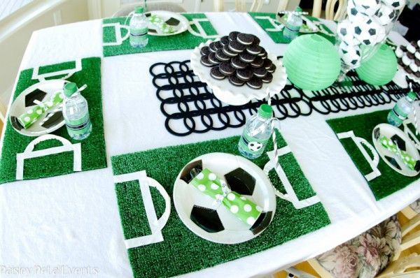 soccer party {Paisley Petal Events}: For the main seating table I started with a white tablecloth and created placemats for each boy out of artificial lawn turf. Then I used white electrical tape to create a soccer field on each placemat – the boys thought this was very cool!