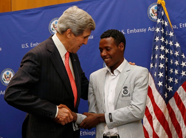 """Winner of the Boston Marathon, Oromo athlete Lelisa Desisa with United States Secretary of State John Kerry at the American Embassy in Oromian Capital, Finfinnee. In a somber ceremony at the American Embassy on Sunday, 26th May 2013,  Lelisa Desisa, the men's winner of this year's Boston Marathon, said he intended to donate his medal to the people of Boston.  """"Sport holds the power to unify people,"""" Desisa said."""