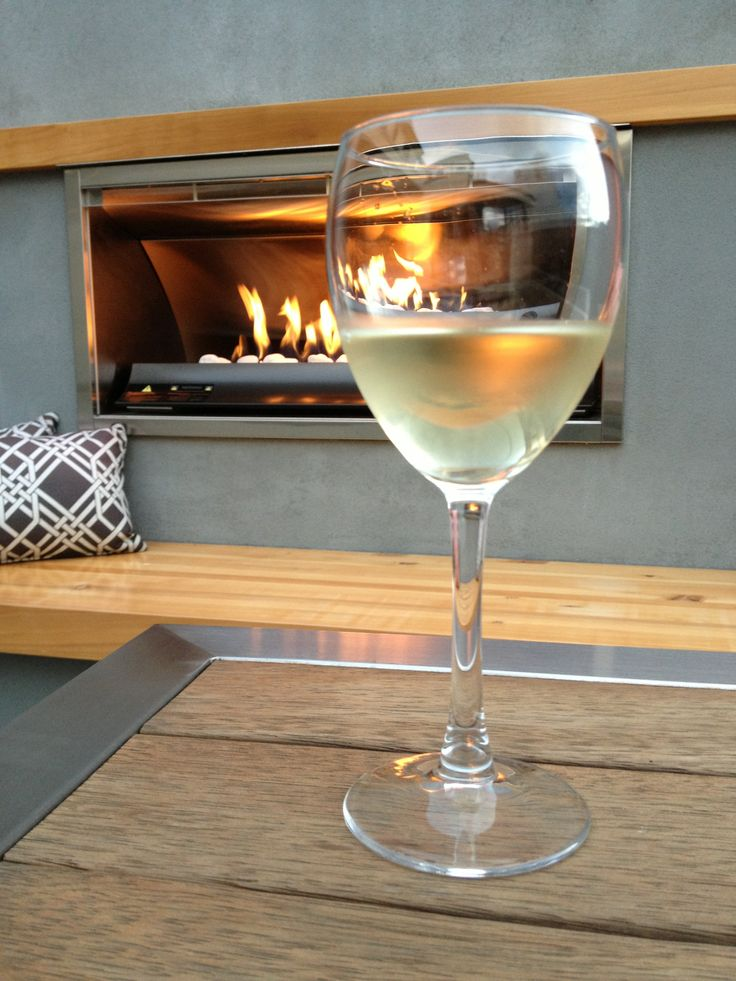Lovely glass of chilled house wine beside our courtyard fire place.