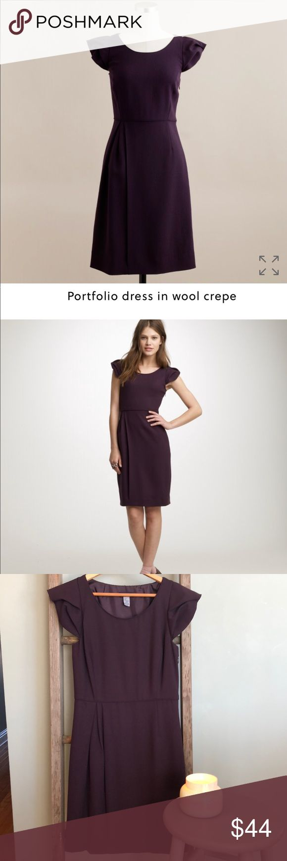 J.Crew Portfolio Dress in Wool Crepe, Deep Plum, 0 J.Crew Portfolio Dress is fashioned from a light wool crepe with a soft matte texture, this little dress is beyond lovely, it's effortlessly chic!  The light fluid fabric keeps the wearing easy and crease free. Flattering side-skirt pleating and adorable cap sleeves! Fitted bodice, side zip, straight skirt. This dress is in excellent condition other than one thread coming loose, as shown in picture. It is on the backside of the right sleeve…