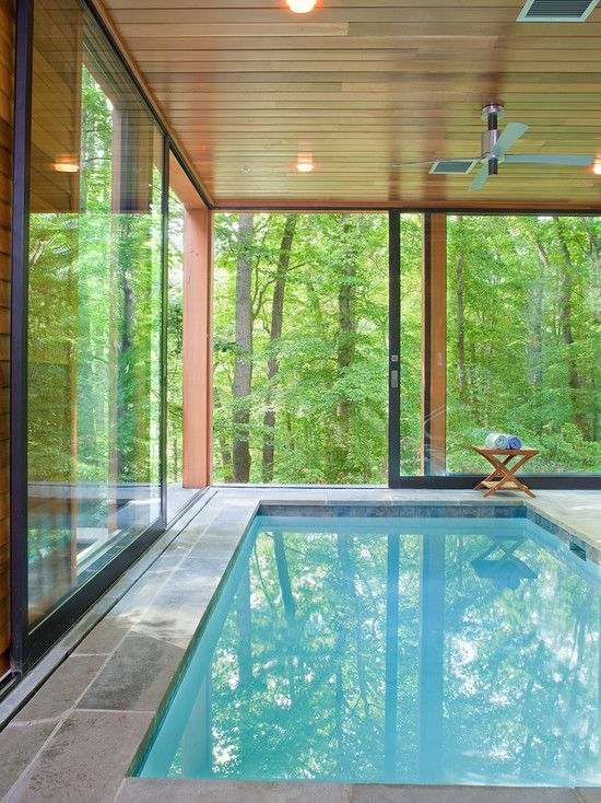 Indoor #pool with sliding glass picture windows. Love how seamless the outside is from the inside!