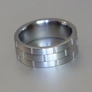 off centre groove-cut titanium ring