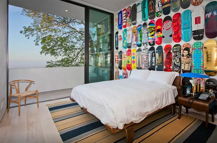 Walls | an artful installation of graphic skateboards that functions as a dramatic headboard
